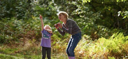 Young girls spotting birds, Sherwood Forest National Nature Reserve, Nottinghamshire, September